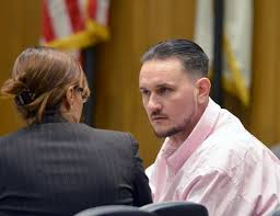 Hall confers with one of his attorneys. (Photo: masslive)