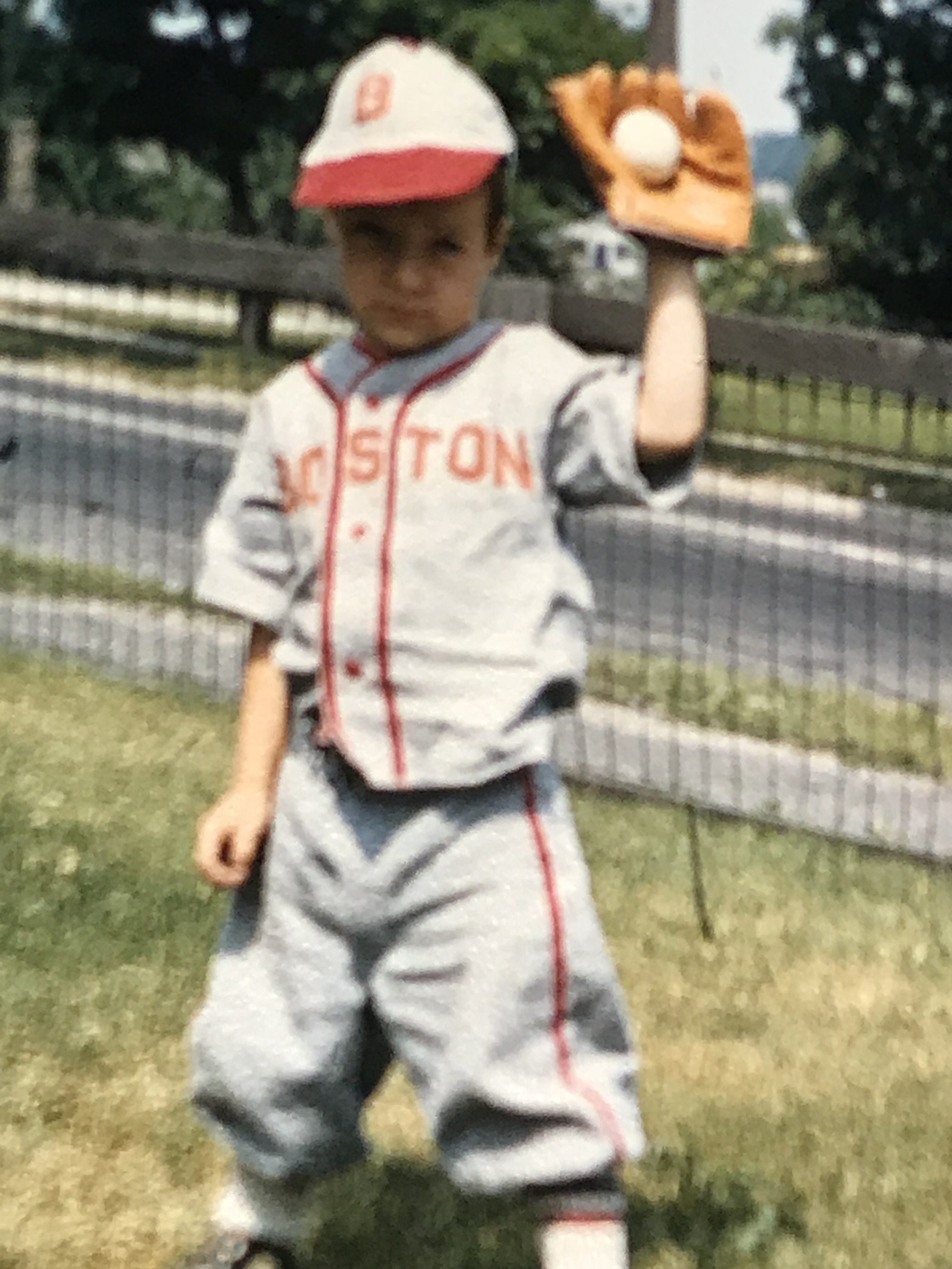 Dan playing baseball as a child