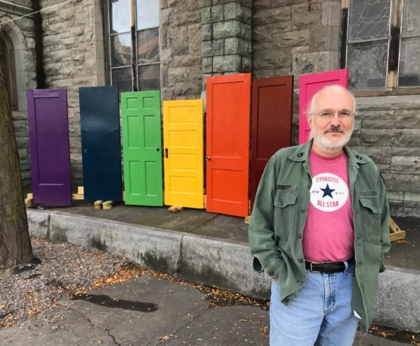 Dan near some colorful doors